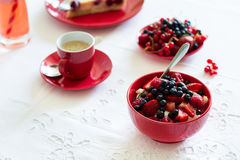 Healthy breakfast: cottage cheese with sour cream, strawberry, raspberry and blueberry, espresso, cherry cheesecake. And plate of fresh ripe berries on white Stock Photo