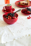 Healthy breakfast: cottage cheese with sour cream, strawberry, raspberry and blueberry, espresso, cherry cheesecake. And plate of fresh ripe berries on white Stock Photography