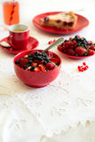 Healthy breakfast: cottage cheese with sour cream, strawberry, raspberry and blueberry, espresso, cherry cheesecake. And plate of fresh ripe berries on white Stock Image