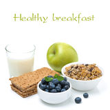 Healthy breakfast - crisp bread, apple, blueberries, milk, muesli Royalty Free Stock Photography