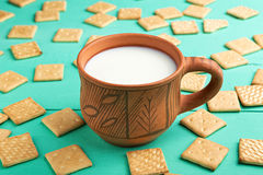 Healthy breakfast cup of milk and crackers, close up, top vew Stock Images