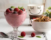 Healthy breakfast: Curd souffle with fresh blueberry, raspberrie. S, granola and tea Stock Photo