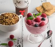 Healthy breakfast: Curd souffle with fresh blueberry, raspberrie. S,multiseed biscuits, granola and tea Stock Images