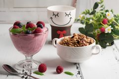 Healthy breakfast: Curd souffle with fresh blueberry, raspberrie. S, granola and tea Royalty Free Stock Image