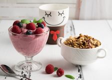 Healthy breakfast: Curd souffle with fresh blueberry, raspberrie. S, granola and tea Royalty Free Stock Photography