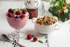 Healthy breakfast: Curd souffle with fresh blueberry, raspberrie. S, granola and tea Royalty Free Stock Images