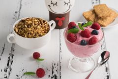 Healthy breakfast: Curd souffle with fresh blueberry, raspberrie. S,multiseed biscuits, granola and tea Royalty Free Stock Photography