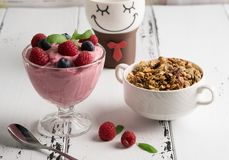 Healthy breakfast: Curd souffle with fresh blueberry, raspberries, granola and tea. Cup Royalty Free Stock Photo