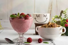 Healthy breakfast: Curd souffle with fresh blueberry, raspberries, granola and tea. Rustic style Stock Image
