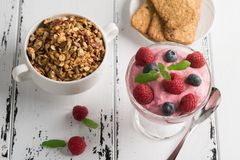 Healthy breakfast: Curd souffle with fresh blueberry, raspberries,multiseed biscuits, granola and tea. Healthy breakfast: Curd souffle with fresh blueberry Royalty Free Stock Images
