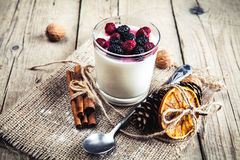 Healthy breakfast - Dairy yogurt with raspberry, mulberry on wooden background. And Royalty Free Stock Image