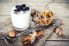 Healthy breakfast - Dairy yogurt with raspberry, mulberry on wooden background. And Royalty Free Stock Photography