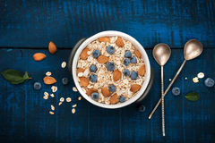 A healthy breakfast on a dark blue wooden background Royalty Free Stock Photography