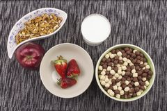 Healthy breakfast, diet meal of cereal, fruit and nuts Royalty Free Stock Image