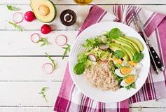 Healthy breakfast. Dietary menu. Oatmeal porridge and avocado salad and eggs. Top view stock image