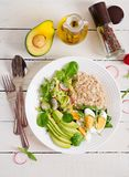 Healthy breakfast. Dietary menu. Oatmeal porridge and avocado salad and eggs. Top view stock photography