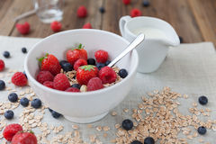 Healthy breakfast. Different berries and muesli on a wooden table Royalty Free Stock Photography