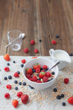 Healthy breakfast. Different berries and muesli on a wooden table Royalty Free Stock Image