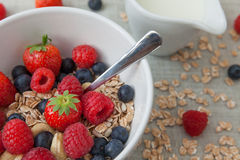 Healthy breakfast. Different berries and muesli on a wooden table Stock Image