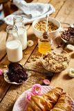Healthy breakfast with different types of breakfast cereal with honey marmalade croissants and milk. Healthy morning breakfast with different types of breakfast royalty free stock photography