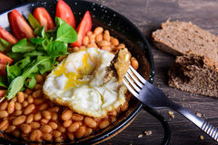 Healthy breakfast with egg, beans and bread Royalty Free Stock Images
