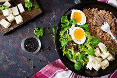 Healthy breakfast with egg, cheese, lettuce and buckwheat porridge on dark background. Proper nutrition. Dietary menu. stock photos