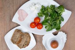 Healthy breakfast with eggs, tomatoes, fresh salad and jam Stock Photography