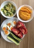 Healthy breakfast eggs, vegetables , mango and avocado. Good right nutrition meal with fruits and vegetables stock images