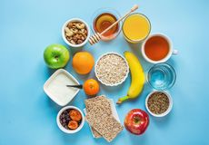 Healthy Breakfast Fiber Sources Digestion Oatmeal Honey Fruits Apples Banana Orange Juice Water Green Tea Nuts. Light Blue Table. Top. Modern Funky Flat Lay Top Stock Images