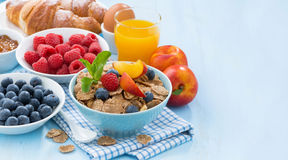 Healthy breakfast with flakes, fresh fruit and berries Stock Photos