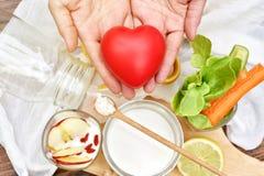 Healthy breakfast food, Kefir grains on wooden spoon, Organic fermented food.