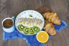 Healthy breakfast. French Croissant ,Coffee and  Kiwi. Healthy Breakfast with orange,kiwi,coffee and french croissant Royalty Free Stock Photos
