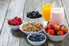 Healthy breakfast with fresh berries on wooden background Royalty Free Stock Photos