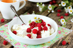 Healthy breakfast: fresh cheese with raspberries Royalty Free Stock Photo