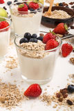 Healthy breakfast with fresh cold yoghurt and fruit. Healthy breakfast with fresh cold yoghurt, strawberries, blueberries and oatflakes in a glass stock photos