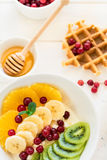 Healthy breakfast: fresh cottage cheese with orange,banana, kiwi, cranberry and honey Royalty Free Stock Photos
