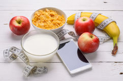 Healthy breakfast: fresh fruit, corn flakes and milk on a wooden Stock Photo