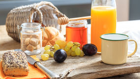 Healthy breakfast with fresh fruits and honey. Fresh fruits and honey on a table royalty free stock photos
