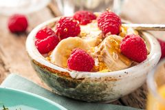 Healthy breakfast. Fresh granola, muesli with yogurt and berries. royalty free stock photo