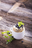 Healthy breakfast. Fresh homemade mug cake with forest blueberries in a white ceramic bowl   sprig of ripe berries on Stock Photography