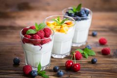 Healthy breakfast fresh yogurt with berry fruits royalty free stock photography