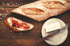 Healthy breakfast. Freshly baked and sliced French baguette with Royalty Free Stock Photo