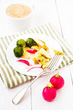 Healthy Breakfast with fried cutted egg, brussels sprouts, radis Stock Photos