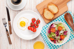 Healthy breakfast with fried egg, toasts and salad stock photos