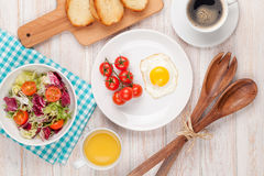 Healthy breakfast with fried egg, toasts and salad Royalty Free Stock ...