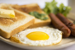 Healthy breakfast fried egg yellow yolk, toast bread, sausage, vegetable in morning Stock Photos