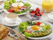Healthy breakfast with fried eggs, avocado stock photography