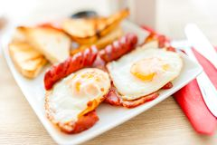 healthy breakfast with fried eggs, bacon, sausages Stock Photos