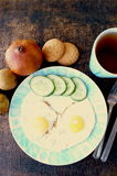 Healthy breakfast, fried eggs, cucumber, fruit, tea royalty free stock images