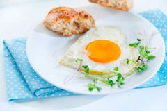 Healthy breakfast. Fried heart shaped egg Royalty Free Stock Image